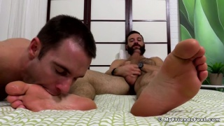 tommy defendi jacks his big cock while getting his feet worshiped