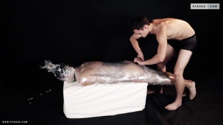 hot stud fucks a bottom mummified in plastic