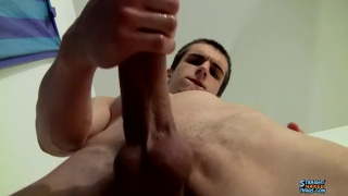 ripped jock strokes his thick cock