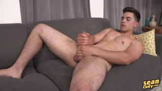 cute stud pat lies back on couch and pumps one out