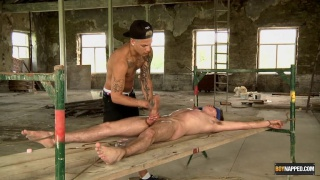sadistic inked master plays with his bound slave