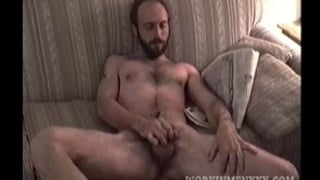 bearded redneck unloads in his fist