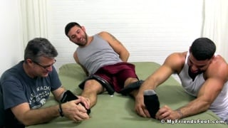 2 men tickling bear cub Seth
