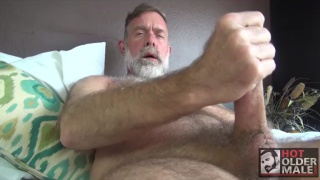 scruffy daddy strokes his long cock