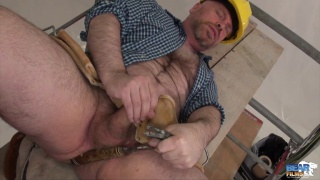 Construction bear strokes his cock