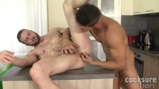 ennio guardi fucks his scruffy-faced buddy in kitchen