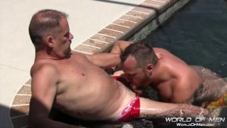sexy daddy gets head in the pool