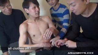 three guys strip buddy out of his clothes