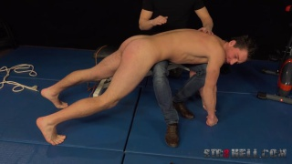 euro lad bent over a fitness bench and spanked