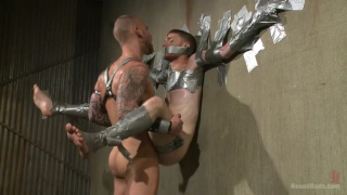 Slave #523 is taped to the wall and fucked