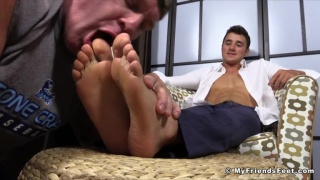 young executive watches foot pig lick his toes