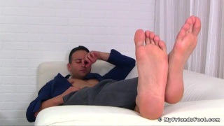 sexy banker plays with bare feet