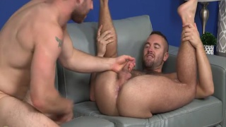 two guys take turns pleasing one another's cocks