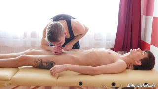 masseur ass fucks his client on massage table