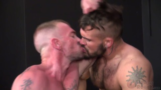 Jacob Slader makes Aarin Asker work for his load