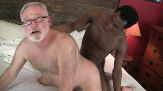 bearded daddy takes a big black cock up his ass
