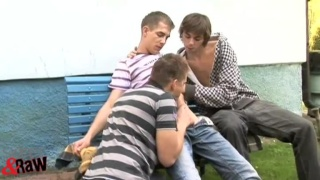 young guys making out in threeway