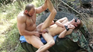 muscular soldier ties up a guy and fucks him