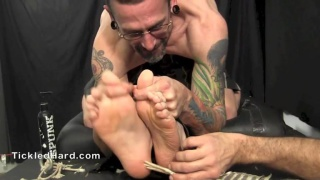 strapped down, nico stiles gets his bare feet tickled