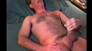 handsome furry man jacks his dick