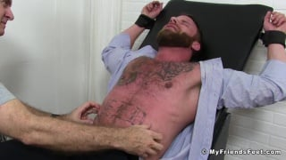 Derek Parker strapped into the tickle chair