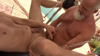 daddy fucks a bottom in a sling poolside