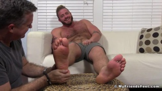 burly dominant stud gets his feet worshipped