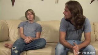 long-haired dude in jeans blows his buddy