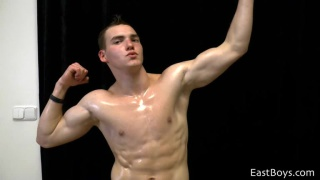 muscle stud oils up and flexes