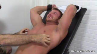 muscled wrestler tied up and tickled