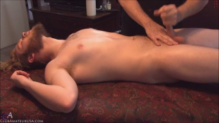 bearded guy hugh gets jacked off on massage table