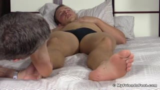 worshipping a sleepy hunk's bare feet