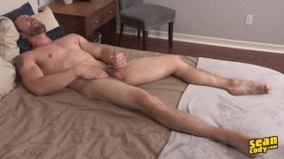 burly mountain man stroking his dick