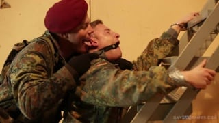 soldier ties up his buddy for some fun
