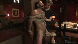beefy hunk bound and edged by two guys