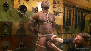 bound Osiris Blade gets his dick serviced