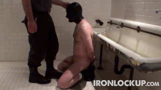 slave on his knees at the piss trough