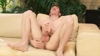geeky brit strokes his uncut dick