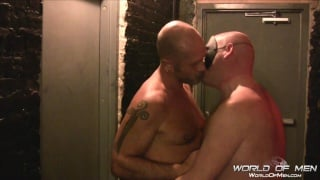 bald men fuck in a leather bar