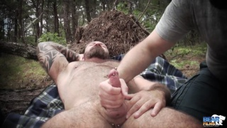 muscle bear marc angelo gets outdoor handjob