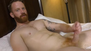 ginger bearded man jerks his 8-inch cock