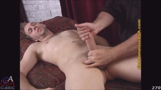 blond hunk dermot gets handjob on the massage table