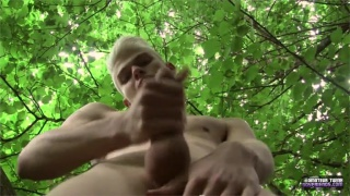 titus jerks his uncut dick in the woods
