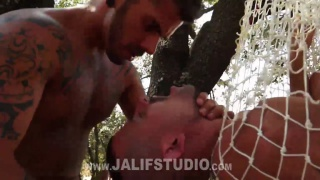 two guys train a new sub in outdoor sex scene
