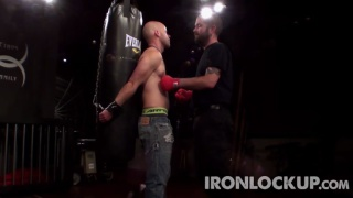 slave chained to the punching bag
