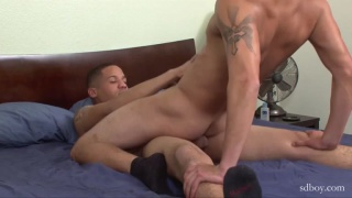 two guys wearing black socks during sex