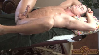 southern adonis serviced on massage table
