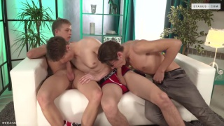 three horny lads sucking dick on couch