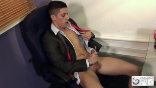young executive wanks off in his office