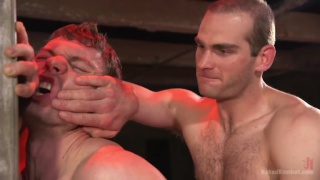 wrestler match loser takes his opponent's stiff dick